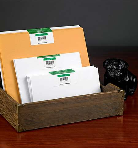 Certified Mail Envelopes in a drawer